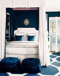 glamorous navy blue wall color for wonderful bedroom decorating ideas with queen four poster bed using flattering white canopy curtain