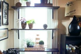 It'll take some maneuvering/removing plants to open the window but the  shelves don't interfere with the function.