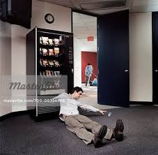 Stuck Vending Machine Delectable Man With His Arm Stuck In A Vending Machine Stock Photo