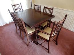 jaycee solid dark oak extending dining table and six chairs