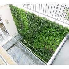 artificial green wall using uv certified foliages outside