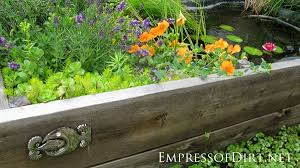 diy patio pond: beautiful backyard pond ideas for all budgets pond in a raised bed