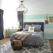 Gray bedroom with striped walls.
