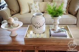 trays can bring order to the items you want to put on a the coffee table items can be a plant book candle and more