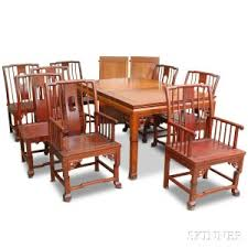 chinese style carved hardwood dining table and eight chairs