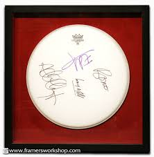 this signed bono drum skin was suspended in a shadowbox frame over red suede and protected with ultraviolet protective glass we are specialists in the