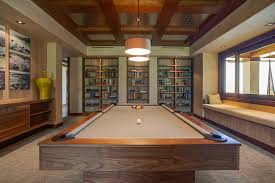 pool table room ideas family room tropical with floating cabinet pendant lights