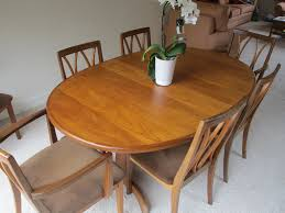 solid teak dining room set dining table eight chairs and two matching storage units