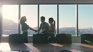 Business People Shaking Hands Consultant Greeting International Clients With Handshake Planning Partnership Deal Female Executive Meeting Shareholders In Corporate Office At Sunset