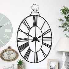 large black oval skeleton clock