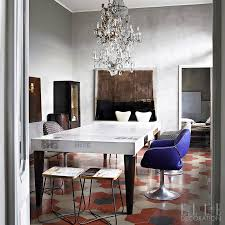 crystal chandeliers create glamour in this italian home cers of lights hang above the