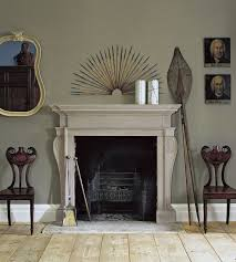 the oxford fireplace in portland stone with the cavendish fire basket and stockton fire irons