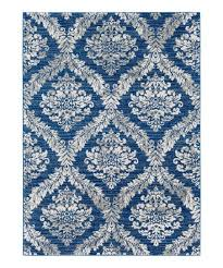 love this blue white damask rug