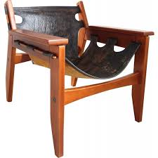 black easy chair in leather and wood by sergio rodrigues produced by oca 1960s