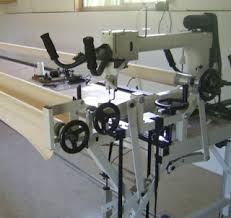 Quilt Fairies at Baylys Beach & Longarm machines has a large throat, sits on wheels which glides up and  down on tracks. With my A1 machine I can quilt a 17 inch wide area in one  pass ... Adamdwight.com