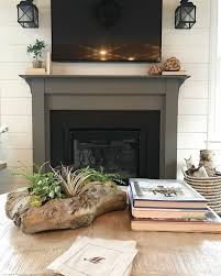 the fireplace surround is painted in sherwin williams gauntlet gray