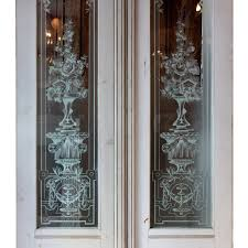the exterior door s windows feature stunning etched glass with decorative details