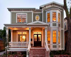 traditional exterior by Whitestone Builders; with a two-story bay window  and the coordinating