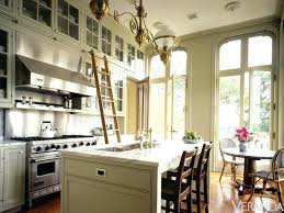 tall upper kitchen cabinets when kitchens have very tall ceilings upper cabinets maximize the use of