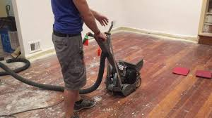 refinishing floors with a drum sander