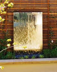 stainless steel water wall with pebbles
