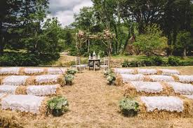 Hay bale seating decor wth vintage lace cloths for a relaxed wedding // The  Natural