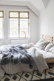bedding deals lifestyle shot of unmade bed