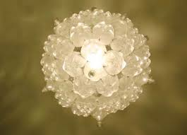 bubble chandelier is an effervescent light fixture made of 60 recycled soda bottles design