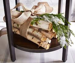 bundle some logs and tie with a burlap ribbon for an easy display