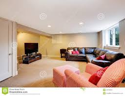 Living Room With Comfortable Leather Couch And Tv Stock Photo - Comfortable tv chair