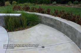 precast coping light sand wash finish patio with square nosed cast concrete coping and tile pool