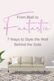 style the wall behind the sofa