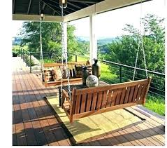 modern porch swing bed screened with content in a cottage outdoor spaces porches