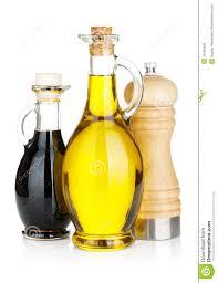 olive oil and vinegar bottles with pepper shaker stock photography