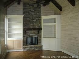 corner fireplace built in bookshelves