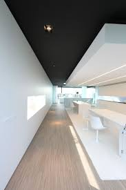 White office area with black ceiling at Luxhome.