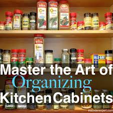 Image of spices in a kitchen cabinet and the phrase, Master the Art of  Organizing