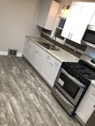 home decorators stony oak grey vinyl plank flooring white shaker with vinyl flooring kitchen white