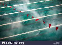 corridor lanes and flags in swimming pool with clean blue water fog over the water