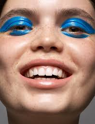 creative closeup portrait with cool blue eye makeup paint creative beauty ediorial ad by renowned