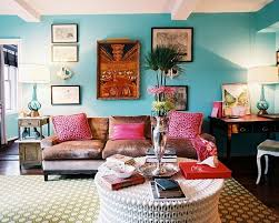 in this living room is different and interesting furniture beautiful sofa with a velvety chocolate finish the pillows on the couch bright fuchsia that bohemian style living room