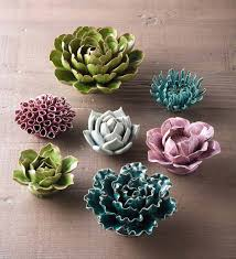 Hand formed from translucent porcelain clay, this highly sculptured wall tiles measures approximately 3.14 x 4 inches and 0.5 inches deep each. Ceramic Floral Wall Art Set Of 7 Vivaterra