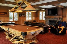 pool table lighting ideas. Country Man Cave With Stone Fireplace, Rustic Pool Table Light, Leather Sofa, Wood Lighting Ideas