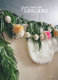 garland made with giant yarn pom poms myfabulesslife com