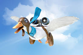 the aflac duck flying through the sky