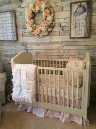 cute rustic baby nursery for the baby girl with pink crib set garland decor on the