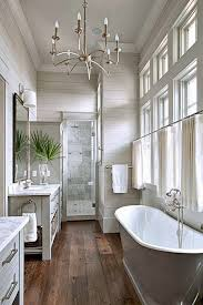 Bathroom with ship-lap siding and wall of windows. #bathroom #designs  homechanneltv