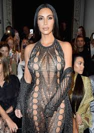 Kim Kardashian goes underwear free in catsuit at Paris Fashion.