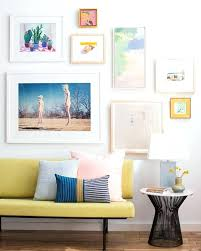 white frame gallery wall living room gallery wall white clean pink green modern black and white white frame gallery wall