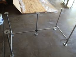 building desk from pipe using a can of white primer spray paint cover the